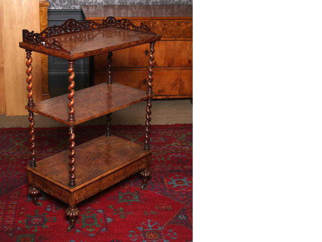 A Victorian figured walnut three tier what-not
