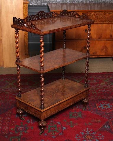 A Victorian figured walnut three tier what-not