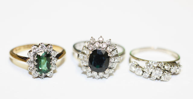 Three gem set dress rings,
