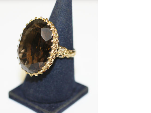 A smoky quartz single stone ring,