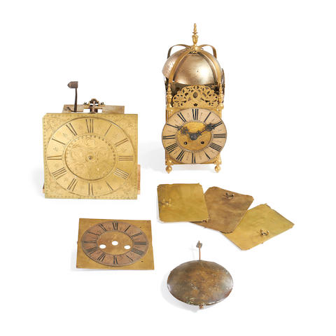 A lantern clock frame together with other clock parts