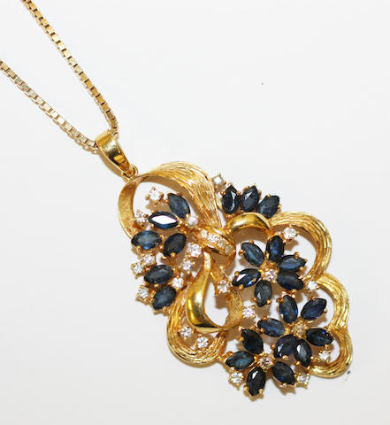 A sapphire and diamond set pendant on chain,