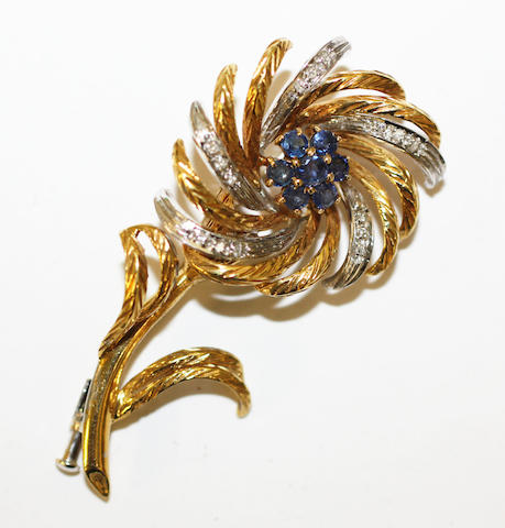 A sapphire and diamond floral spray brooch