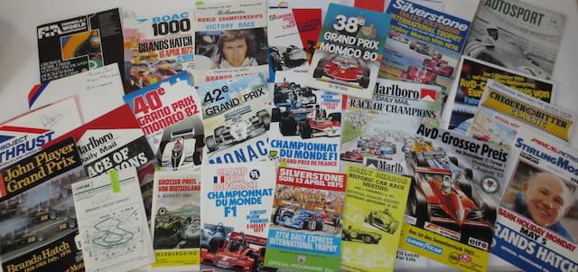 A collection of driver signed race programmes,