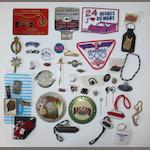Assorted car and lapel badges,