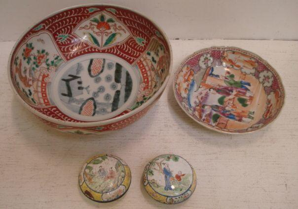 A pair of Canton enamelled shallow circular seal cases and covers, painted with figures and floral panels, 6cm, a Chinese 'famille rose' saucer, and an Imari bowl painted with panels of flowers and animals. (4)