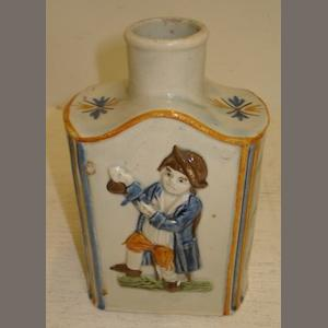 A Pratt Ware tea canister, circa 1800, rectangular with raised figure panels, the bowed sides with branches of flowers, painted in colours, 13.5cm.