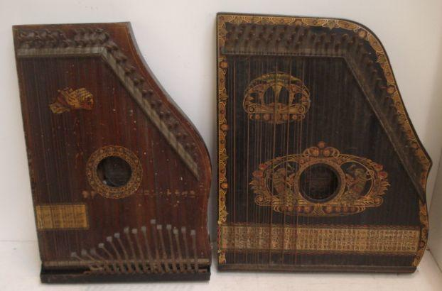 Two Zithers, one labelled 'The Piano Chord', in ebonised gilt decorated cases, four tambourines and two cymbals.