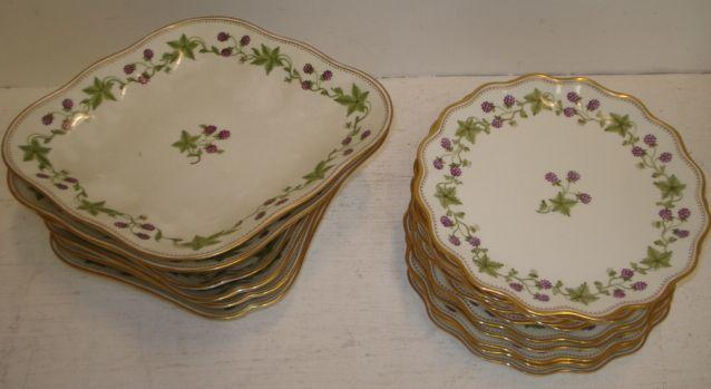 A Wedgwood dessert service, painted with fruiting vines, twelve plates and six dishes. (18)