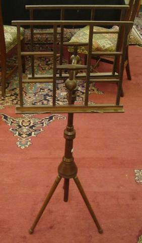 A Wheeldons Patent mahogany duet music stand, with adjustable telescopic column, the spreading circular base on ring turned splayed legs.
