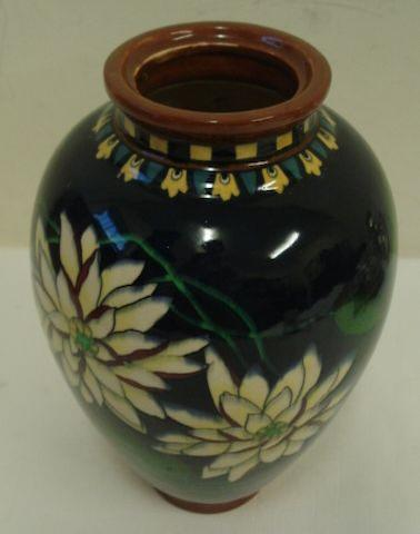 A Wiley Foley Intarsio decorated vase, of baluster shape and decorated with waterlilies and leaves in yellow, cream and green on a dark blue ground, 25cm.
