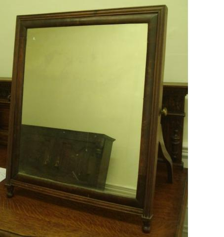 A 19th Century toilet mirror, the cushion plate hinged in square moulded frame with shaped back strut, 68cm x 55cm.