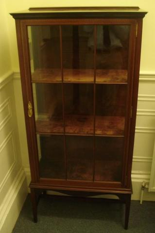 An early 20th Century inlaid mahogany display cabinet, having a nine panel glazed door enclosing three shelves on square tapered stretchered legs, 73cm.