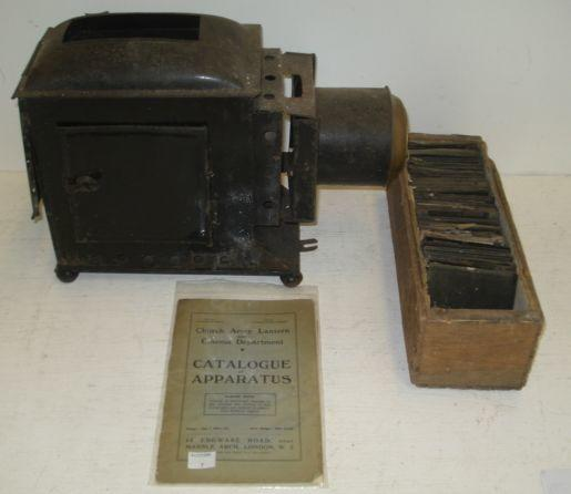 A Japanned metal and brass magic lantern, a large collection of glass slides in two cases and a Church Army Lantern catalogue of Apparatus.