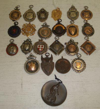 Of Cycling Interest:  a collection of 23 medals, the majority awarded to R C Brown, including two 9ct gold examples and 16 silver examples, some decorated in coloured enamels, extensively inscribed, largely from 1938/39, but some earlier in date.