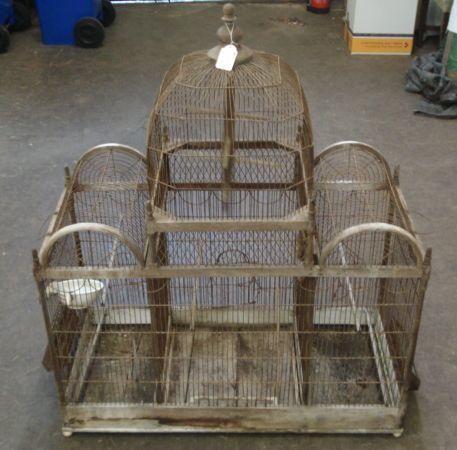 A Victorian wooden frame wire-work bird cage, the centre section with domed octagonal top,92cm.