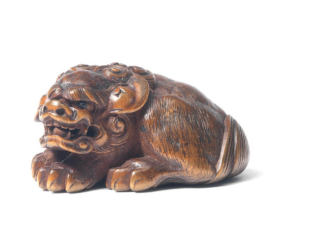 A boxwood netsuke of a shishi By Masayoshi, Nagoya, 19th century