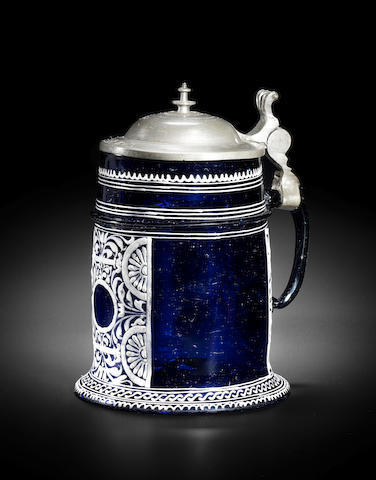 A Bohemian enamelled blue-tinted tankard with pewter mount, mid 17th century