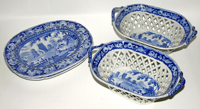 A pair of 19th century stoneware blue and white baskets on stands