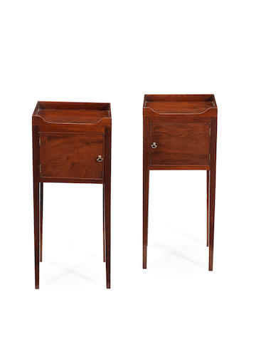 A pair of late George mahogany III bedside cupboards