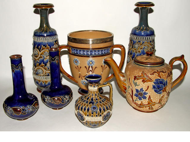 A collection of seven pieces of Doulton Lambeth stoneware comprising: