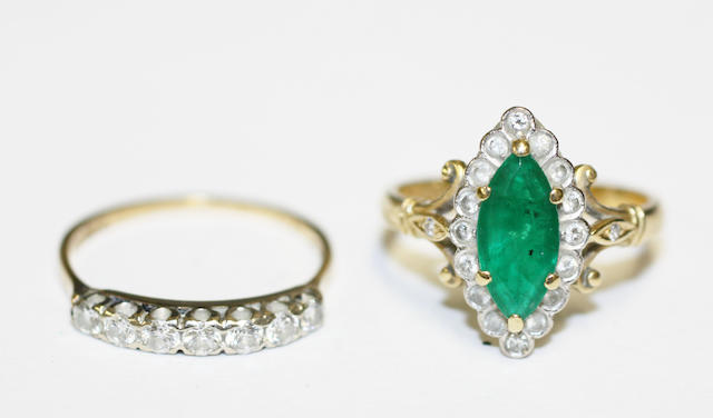An emerald and diamond cluster ring and a diamond half hoop ring,