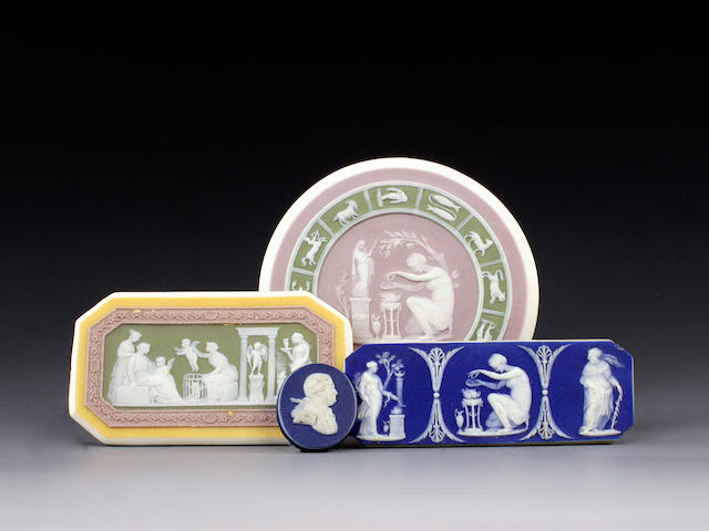 A Wedgwood tri-colour jasper 'Zodiac' medallion and three other medallions or plaques, late 18th or early 19th century