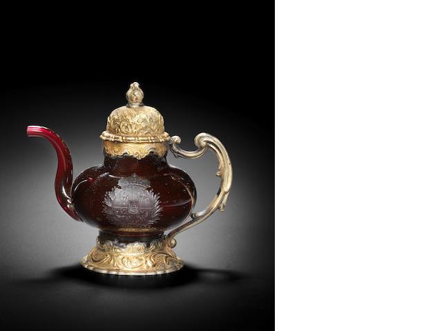 A rare Dresden engraved silver-gilt mounted armorial Rubinglas teapot, Dresden, circa 1713-18, the mounts circa 1750