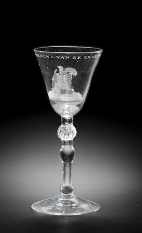 A Dutch engraved light-baluster wine glass, attributed to Jacob Sang, circa 1760