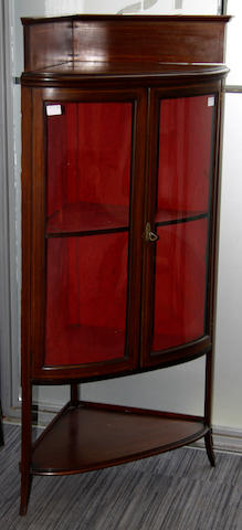 An Edwardian mahogany and boxwood strung D-shaped corner cabinet
