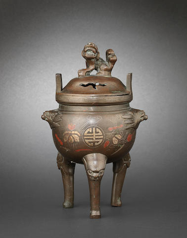 A bronze incense burner and cover