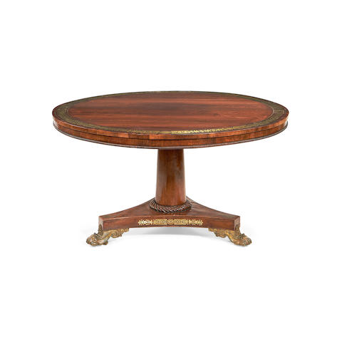 A Regency rosewood and brass inlaid breakfast table