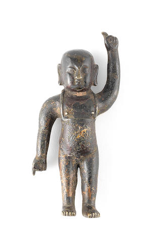 A parcel-gilt bronze figure of the Buddha as a boy Ming or Qing Dynasty