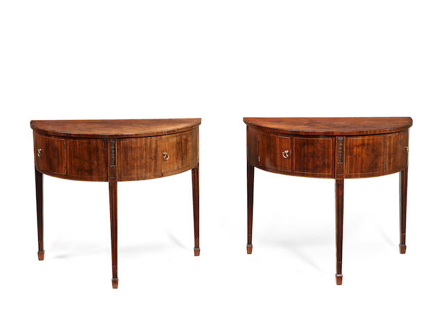 A pair of George III mahogany barbers pole strung eliptical side tables