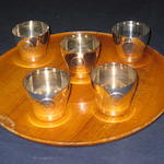 A set of five 20th century German white metal beakers, tray