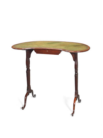 A small George III mahogany kidney shaped writing table