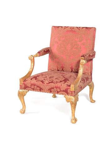 A George II carved and later gilded Gainsborough armchair