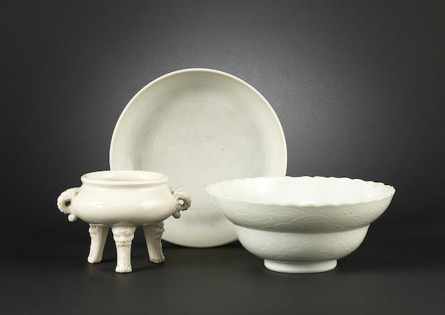 A white-glazed dish Longqing four-character mark and possibly of the period