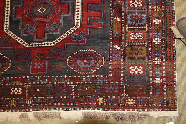 A West Persian rug 282cm x 149cm.