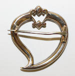 A diamond heart brooch