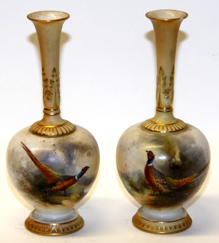 A pair of Royal Worcester painted bottle vases, signed Jas Sinton  Circa 1911
