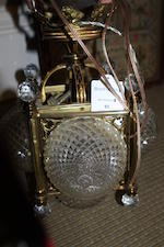 A pair of early 20th century brass & cut glass electric lanterns
