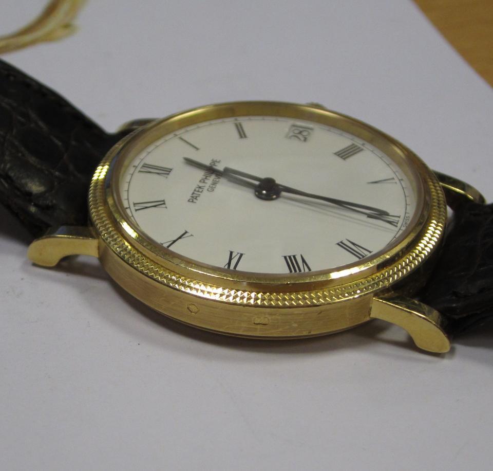Patek Philippe. An 18ct gold automatic calendar wristwatchCalatrava, Ref:3802/200, Case No.4037264, Movement No.3007729, Circa 2005