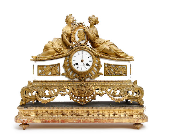 A French 19th century gilt bronze figural mantle clock depicting Moliere between muses dressed as Comedy and Tragedy F. L. Hausberg, Paris