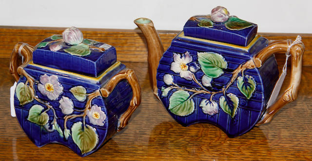 An English majolica teapot and cover and sucrier and cover, 19th century