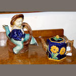 An English majolica teapot and cover and an Isle of Man Manx teapot and cover, late 19th century