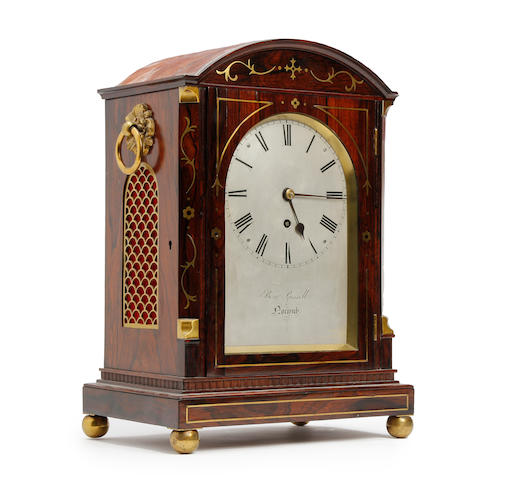 A fine early 19th century rosewood and brass inlaid bracket timepiece B Russell of Norwich.