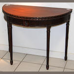 A George III mahogany crossbanded demi-lune card table of Neo-Classical design,