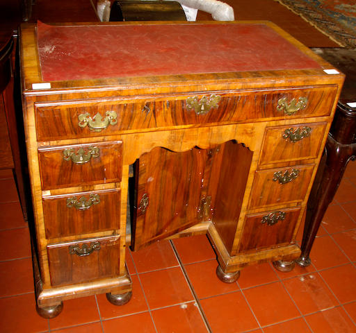 A walnut veneered kneehole desk, 18th Century and later