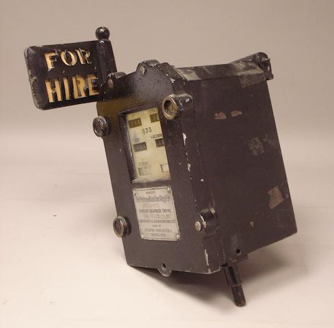 An Austin FX3 Taxi meter, 1950s,